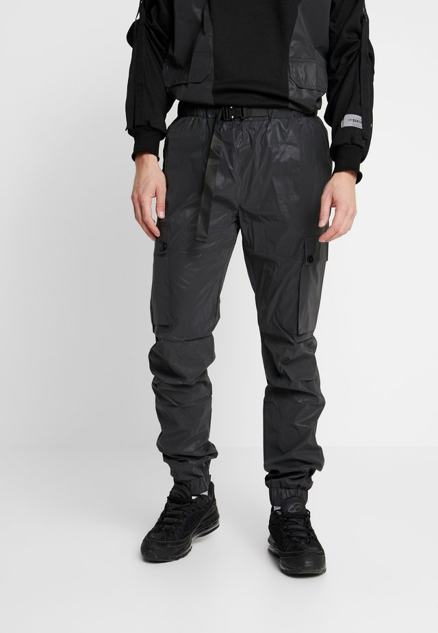 REFLECTIVE CARGO PANTS - Cargo trousers - black