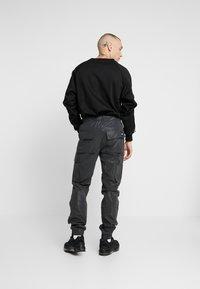 Sixth June - REFLECTIVE CARGO PANTS - Pantaloni cargo - black - 2