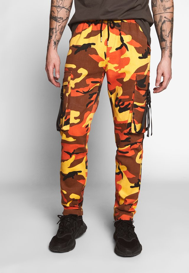 CAMO PANTS - Cargo trousers - orange