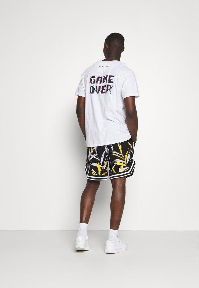 BANANA TROPICAL - Shorts - black