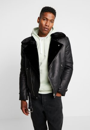 CLASSIC OVERSIZE PERFECTO - Faux leather jacket - black