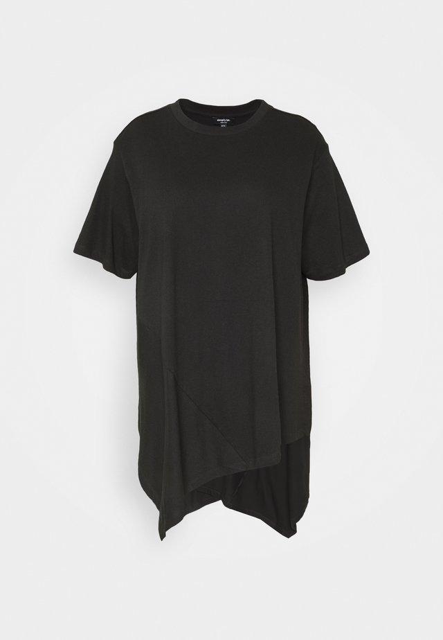 ASYMMETRIC - T-shirt med print - black