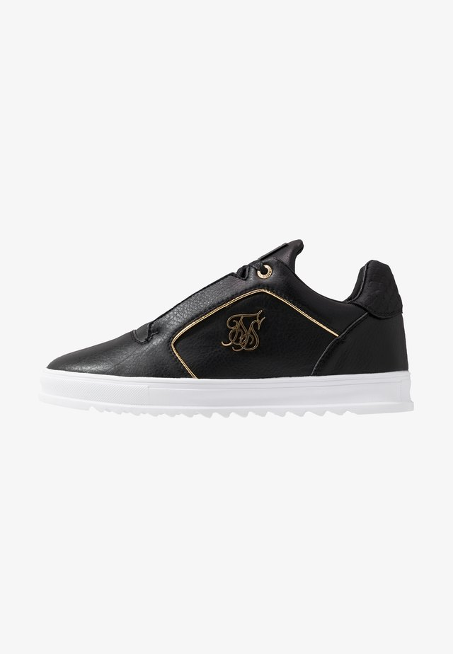 STORM - Sneaker low - black/gold