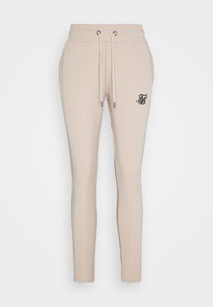 ZONAL TRACK PANTS - Teplákové kalhoty - beige