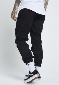 SIKSILK - FITTED CUFF PANTS - Cargobyxor - black - 2
