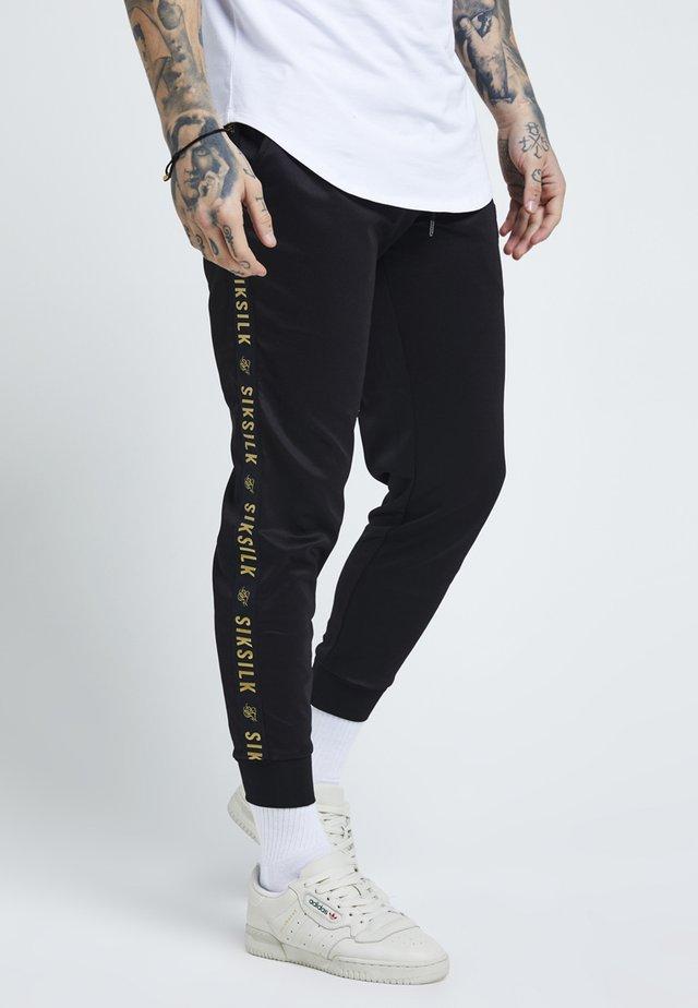 Jogginghose - black/gold