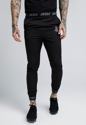 PERSUIT PANT - Verryttelyhousut - black