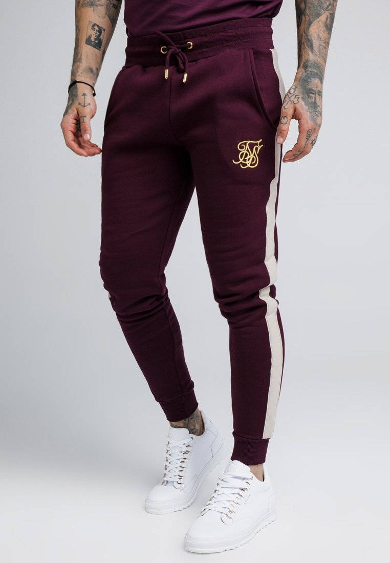 SIKSILK - CUT AND SEW TAPED PANTS - Pantalones deportivos - burgundy/cream