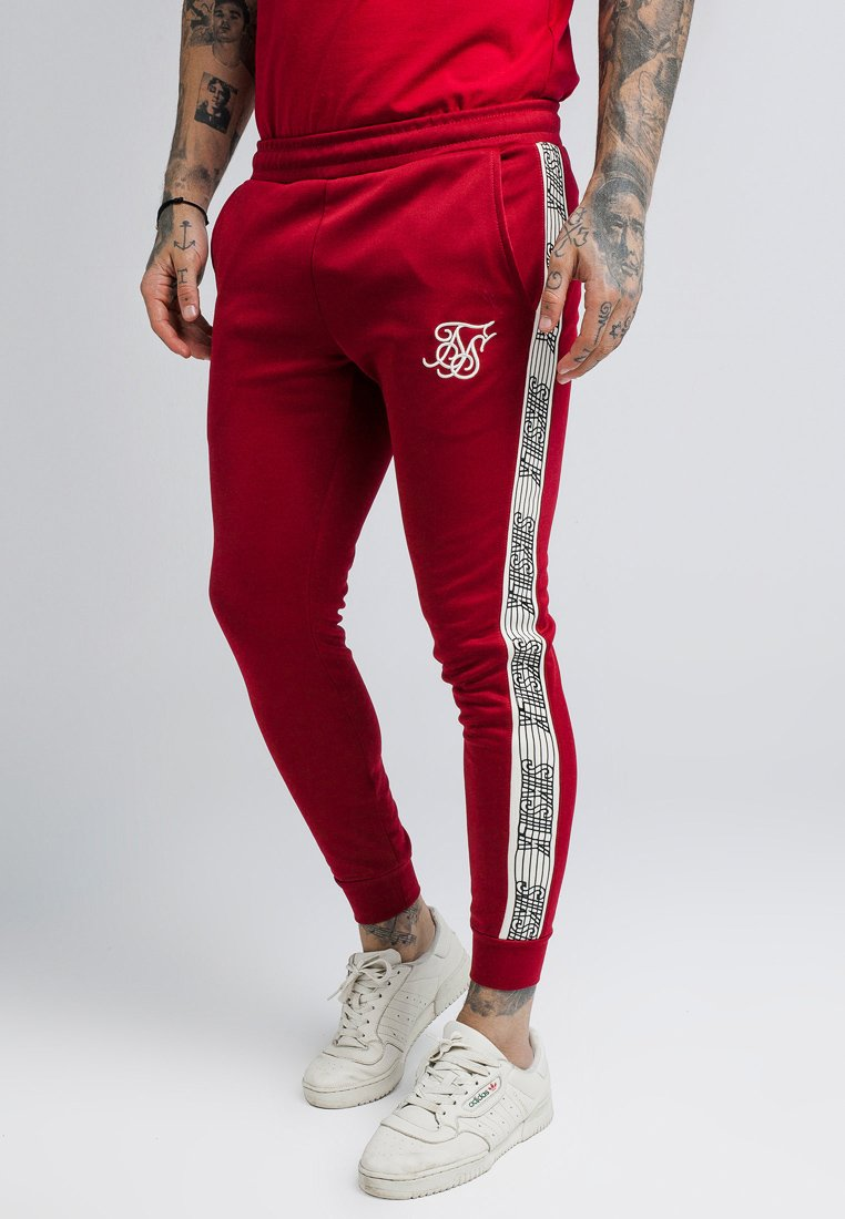 SIKSILK - CUFFED RUNNER PANTS - Tracksuit bottoms - red