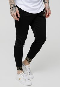 SIKSILK - AGILITY TRACK PANTS - Pantalones deportivos - black - 0