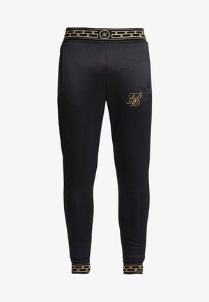 AGILITY TRACK PANTS - Teplákové kalhoty - black