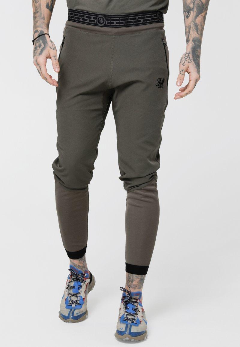 SIKSILK - EVOLUTION TRACK PANTS - Verryttelyhousut - khaki