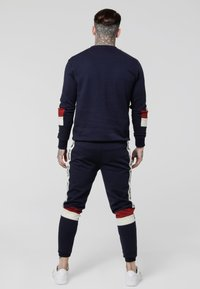 SIKSILK - RETRO PANEL TAPE - Tracksuit bottoms - navy/red/off white - 2