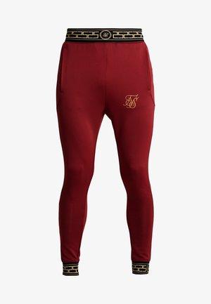 AGILITY TRACK PANTS - Pantaloni sportivi - red