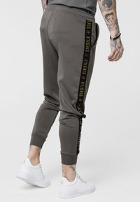 SIKSILK - CUFFED CROPPED TAPED  - Tracksuit bottoms - cement - 4