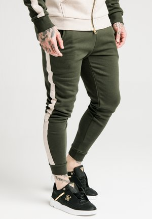 PANELLED - Tracksuit bottoms - khaki/cream/gold