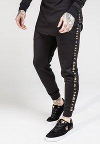 SIKSILK - CUFFED CROPPED TAPED  - Teplákové kalhoty - black - 0