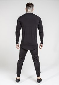 SIKSILK - CUFFED CROPPED TAPED  - Pantalon de survêtement - black - 2