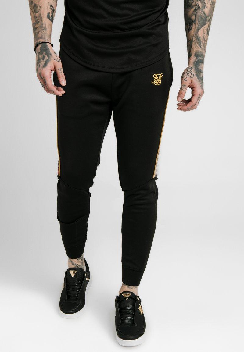SIKSILK - DANI ALVES CUFFED PANELLED JOGGER - Teplákové kalhoty - black