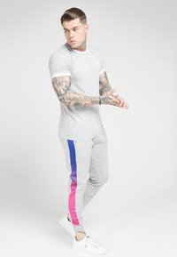 SIKSILK - MUSCLE FIT FADE PANEL - Pantalon de survêtement - grey marl/neon - 1