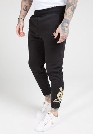 FITTED  - Tracksuit bottoms - jet black/gold