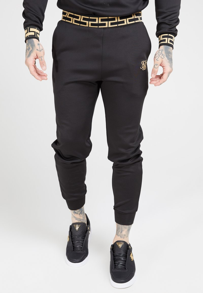 SIKSILK - FITTED CUFFED CHAIN PANT - Joggebukse - black/gold