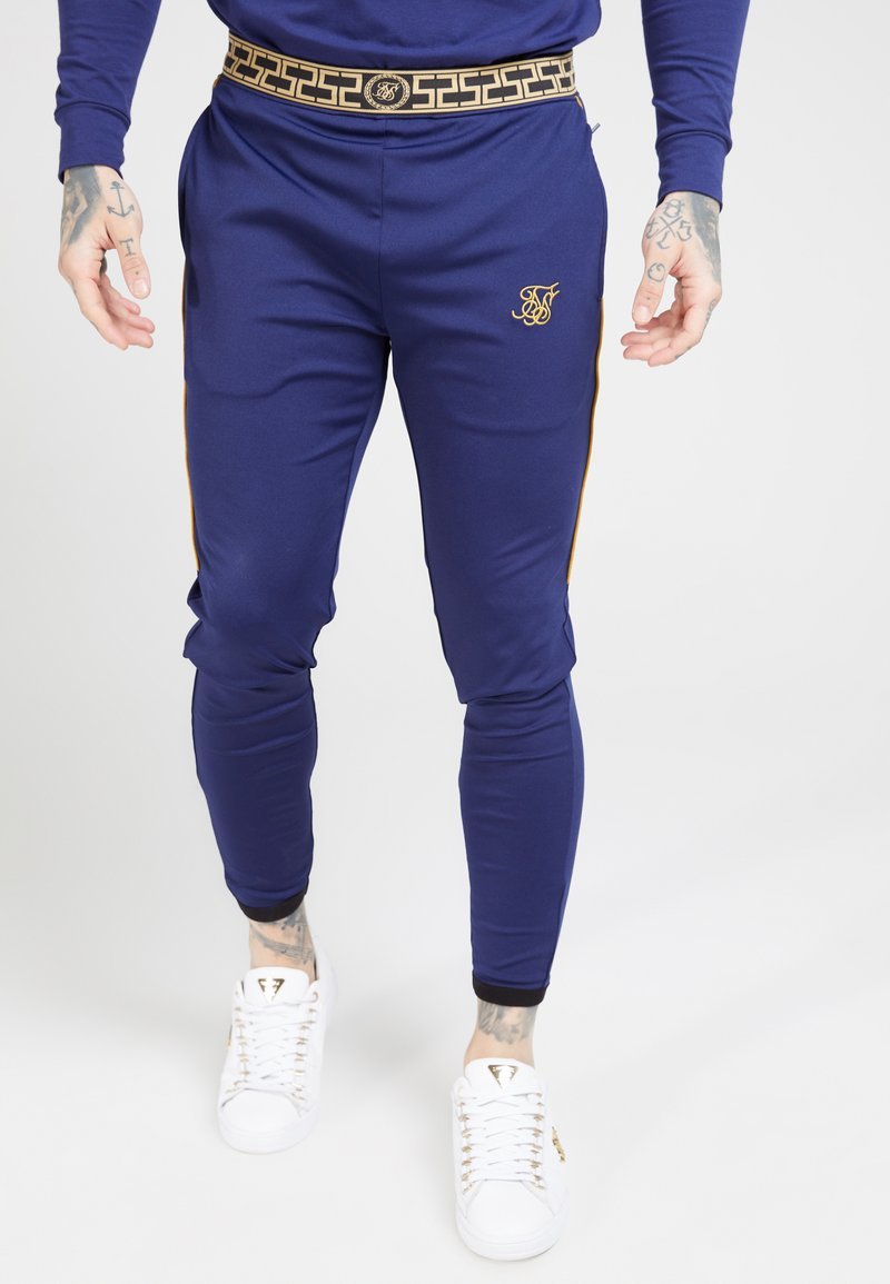 SIKSILK - SCOPE TRACK PANTS CARTEL - Pantalon de survêtement - navy/gold