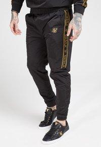 SIKSILK - CRUSHED TAPE  - Pantaloni sportivi - black / gold - 4
