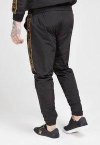 SIKSILK - CRUSHED TAPE  - Pantaloni sportivi - black / gold - 2
