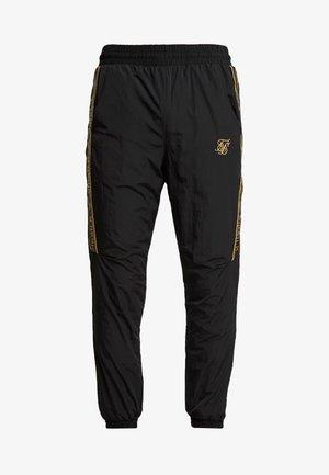 CRUSHED TAPE  - Pantaloni sportivi - black / gold