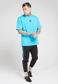 SIKSILK - FITTED TAPE TRACK PANTS - Tracksuit bottoms - black/teal - 1