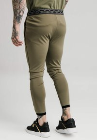 SIKSILK - SCOPE TRACK PANTS - Tracksuit bottoms - khaki