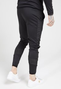 SIKSILK - CREASED PANTS - Trainingsbroek - black - 2