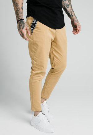 PANTS - Pantalones chinos - tan