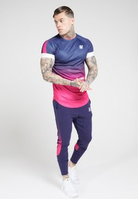 SIKSILK - ATHLETE TECH FADETRACK PANTS - Joggebukse - navy/neon fade - 1