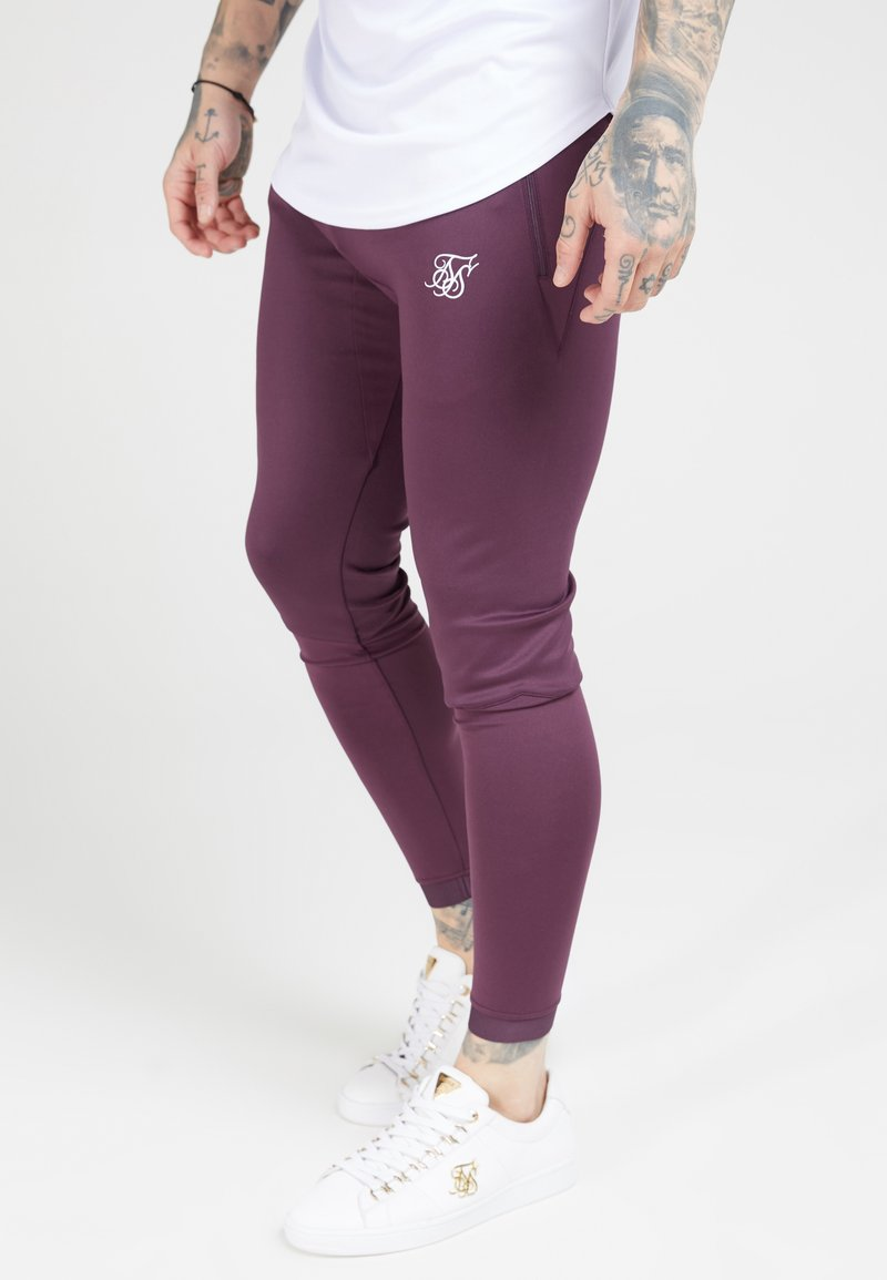 SIKSILK - EVO HYBRID TRACK PANTS - Pantalon de survêtement - rich burgundy