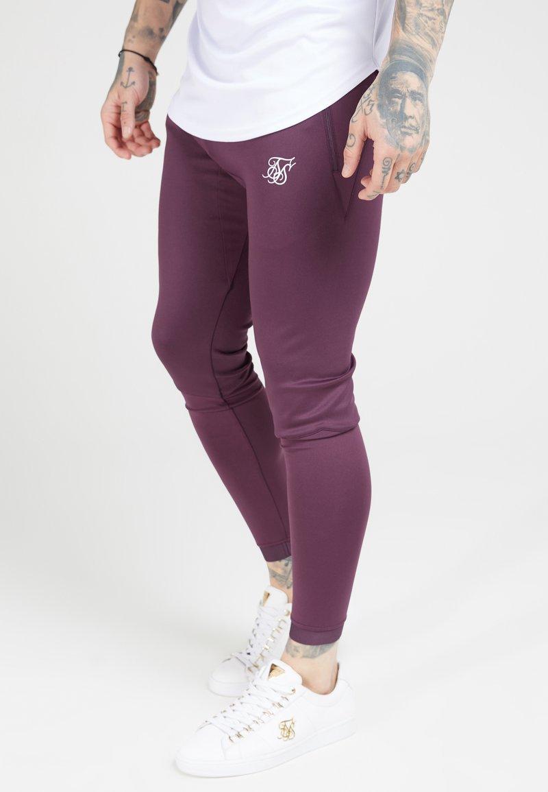 SIKSILK - EVO HYBRID TRACK PANTS - Teplákové kalhoty - rich burgundy