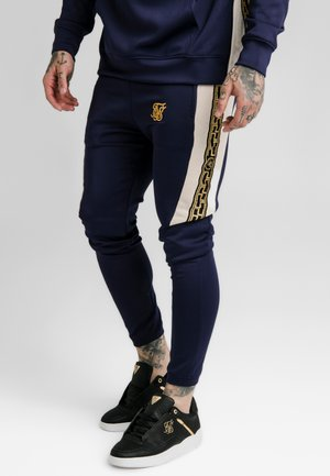 HYBRID PANEL TAPE FITTED PANTS - Pantalon de survêtement - navy