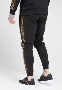 SIKSILK - MUSCLE FIT NYLON PANEL JOGGERS - Tracksuit bottoms - black/gold - 2