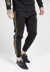 SIKSILK - MUSCLE FIT NYLON PANEL JOGGERS - Tracksuit bottoms - black/gold - 0