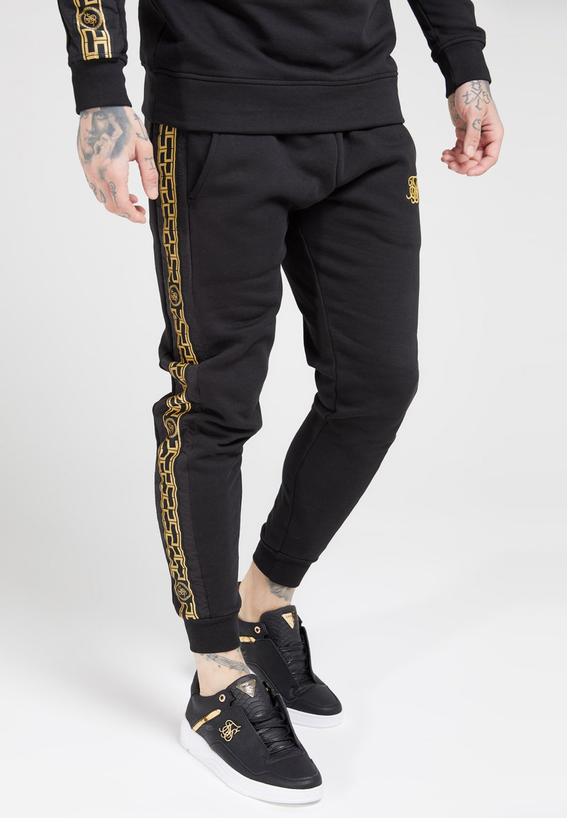 SIKSILK - MUSCLE FIT NYLON PANEL JOGGERS - Tracksuit bottoms - black/gold
