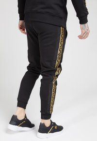 SIKSILK - MUSCLE FIT NYLON PANEL JOGGERS - Tracksuit bottoms - black/gold - 4