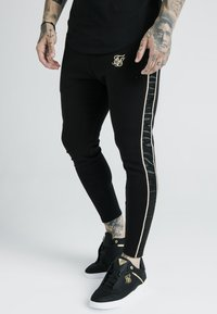 SIKSILK - DANI ALVES ATHLETE BRANDED TRACK PANTS - Pantalones deportivos - black - 0