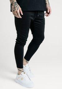 SIKSILK - X DANI ALVES ATHLETE TRACK PANTS - Tracksuit bottoms - black - 0