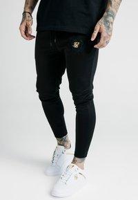 SIKSILK - X DANI ALVES ATHLETE TRACK PANTS - Tracksuit bottoms - black - 4