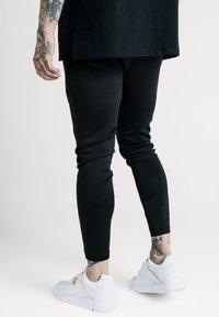 SIKSILK - X DANI ALVES ATHLETE TRACK PANTS - Tracksuit bottoms - black - 2