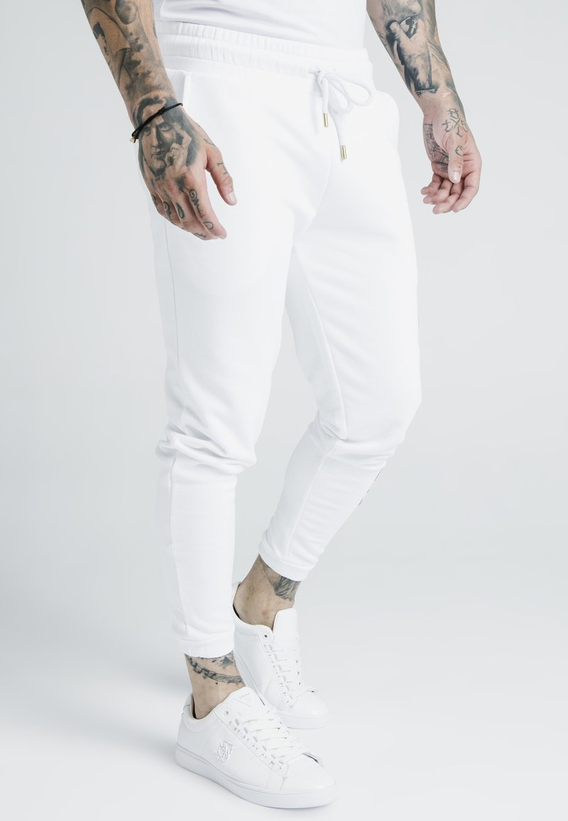 SIKSILK - X DANI ALVES CUFFED JOGGERS - Tracksuit bottoms - white