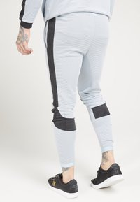 SIKSILK - ATHLETE EYELET TAPE TRACK PANTS - Trainingsbroek - ice grey/charcoal - 2