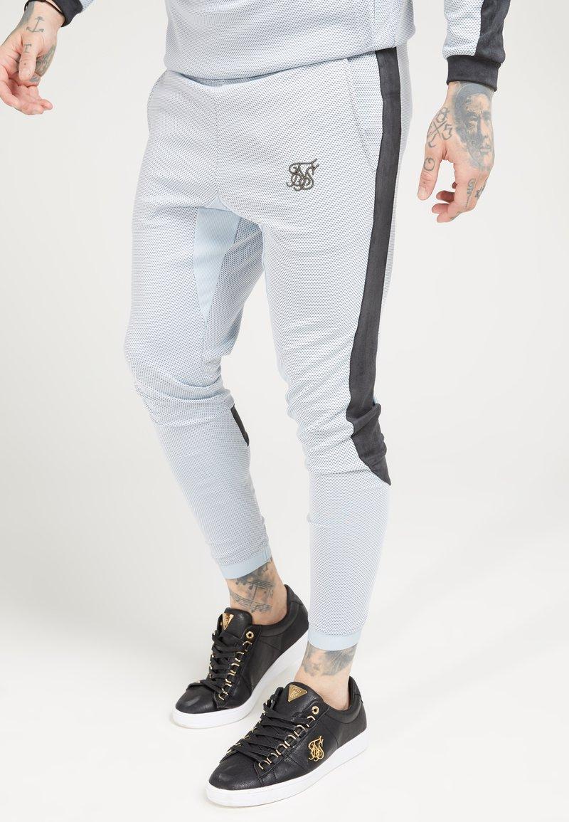 SIKSILK - ATHLETE EYELET TAPE TRACK PANTS - Trainingsbroek - ice grey/charcoal