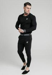 SIKSILK - LOUNGE PANTS - Teplákové kalhoty - black - 1